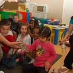 reptile zoo experience at daycare with teachers and class