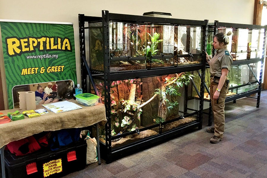 Reptilia Mobile Zoo display with host standing in front