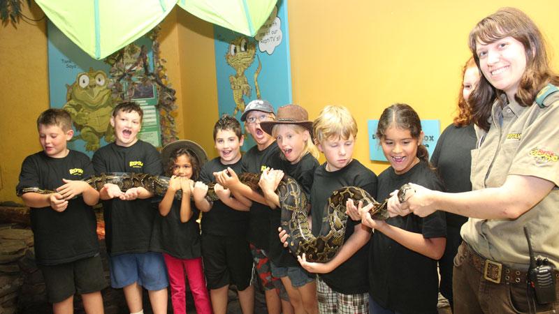 RECF Sponsor Campers holding snake